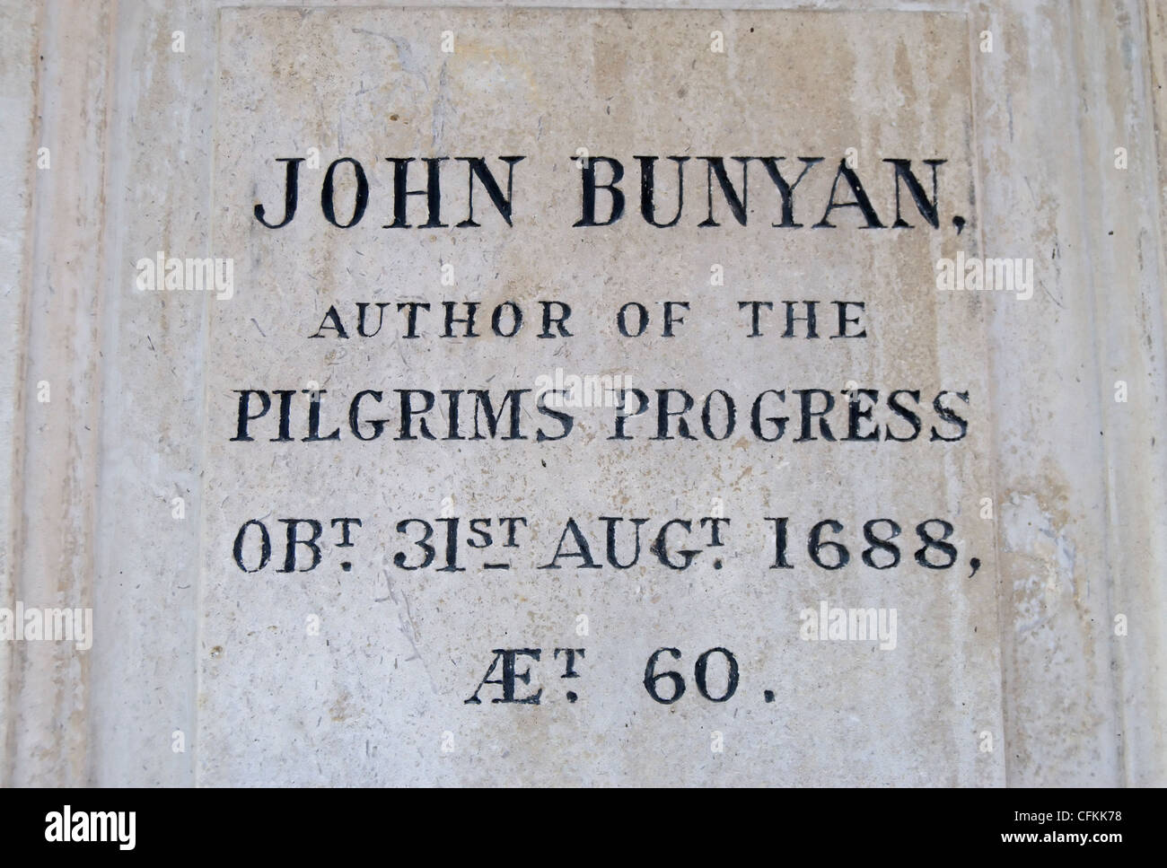 inscription on the grave of author john bunyan at bunhill fields cemetery, london, england - Stock Image