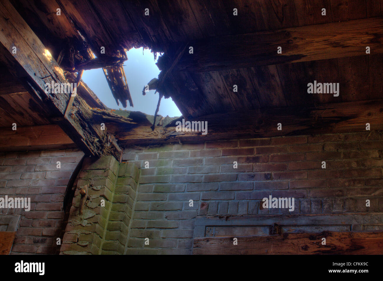 Hole in the roof of an old barn - Stock Image