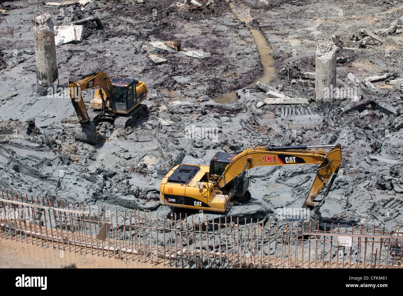 Mechanical Excavators Working in Mud - Stock Image