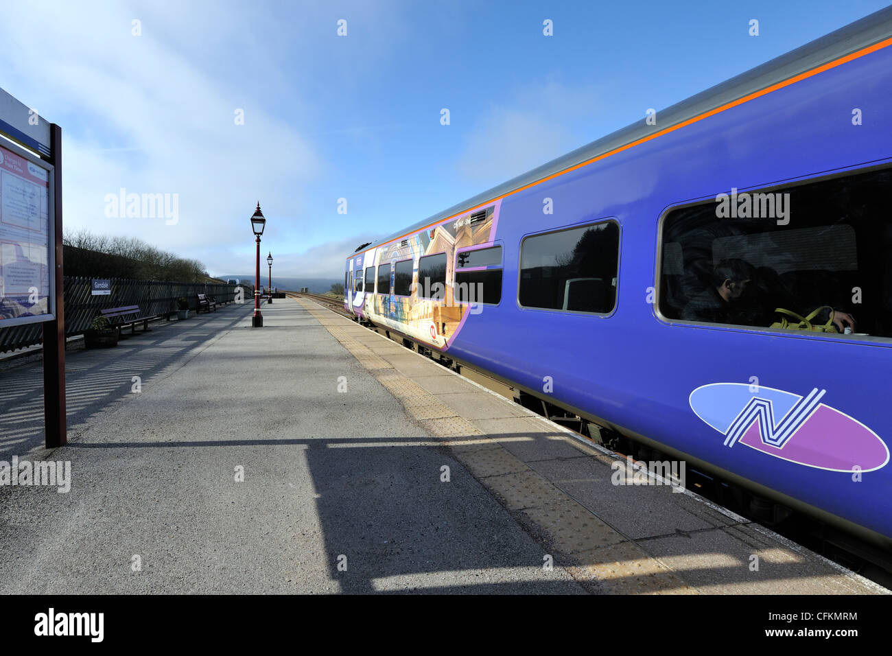 A Northern Rail train at Garsdale station, Carlisle to Settle railway line, Yorkshire Dales, England - Stock Image
