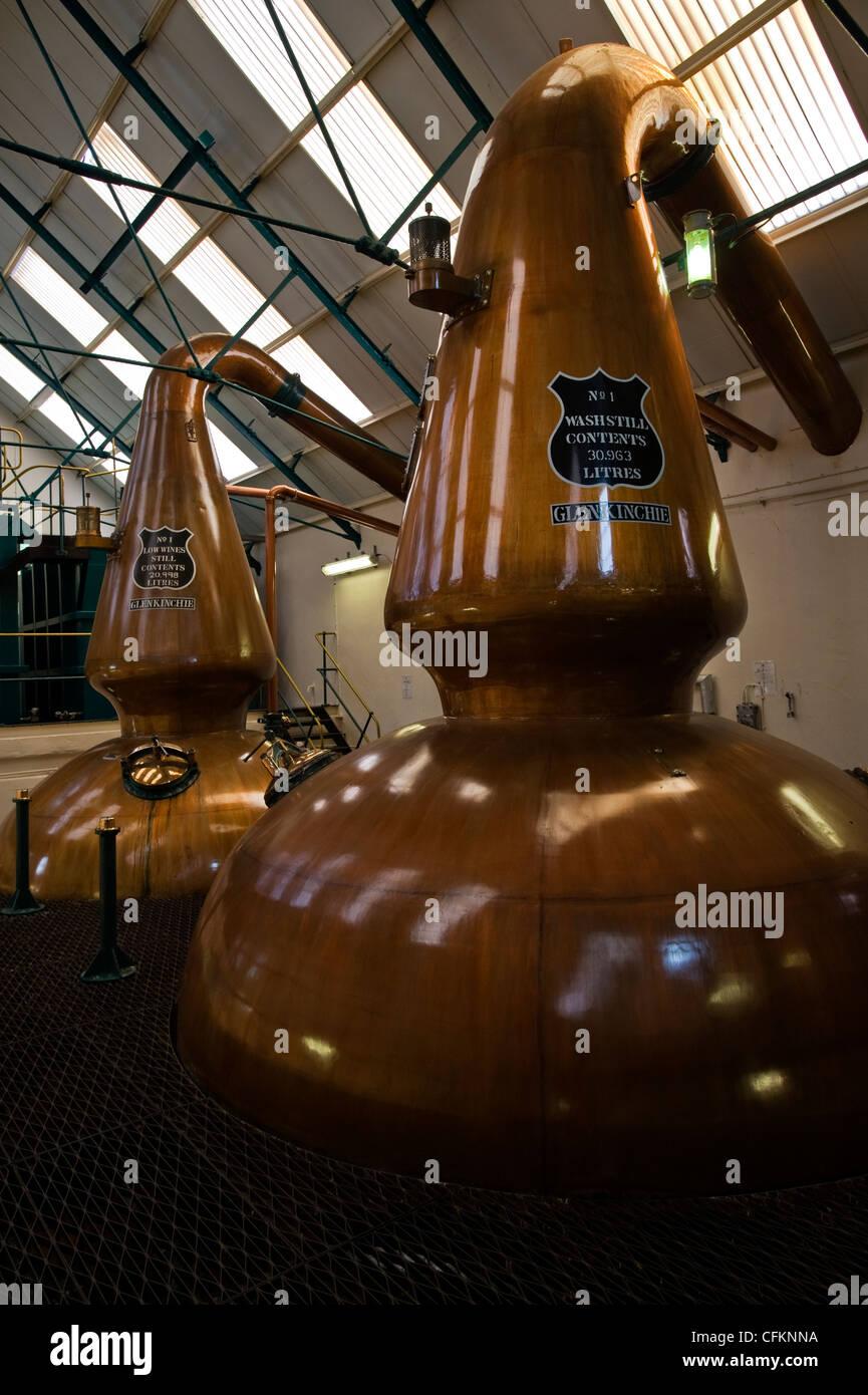 Copper stills in a whisky distillery in  Scotland - Stock Image