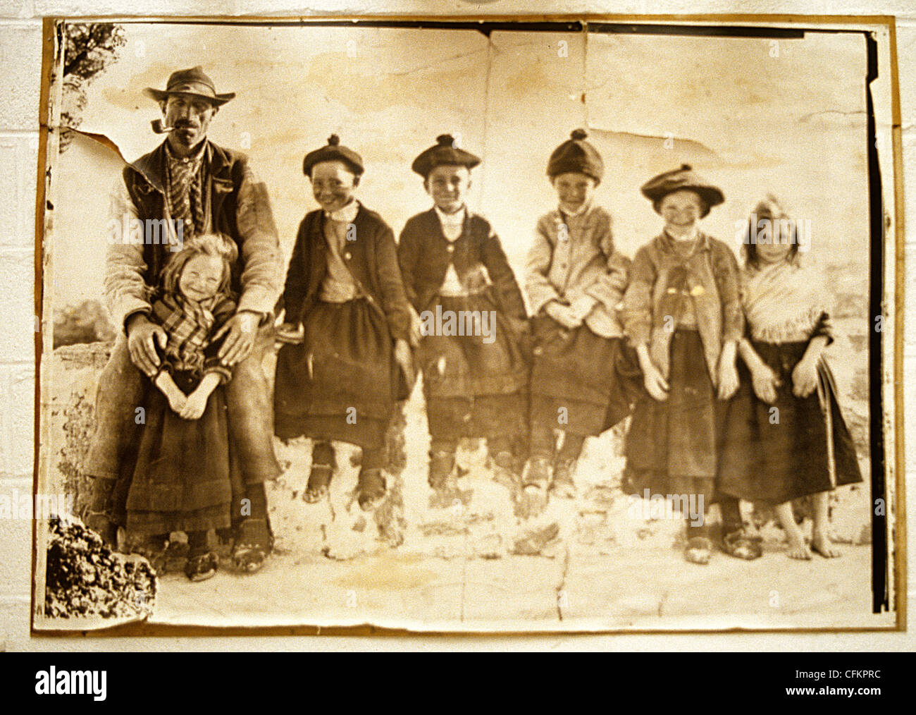 Copy of a vintage sepia photograph  of Aran Islanders wearing characteristic island dress, - Stock Image