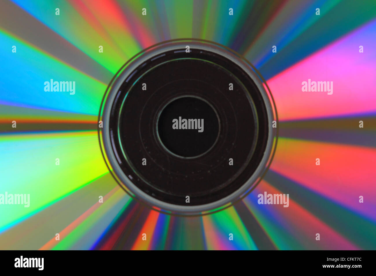 Macro picture of compact disc with mutlicoloured lights - Stock Image