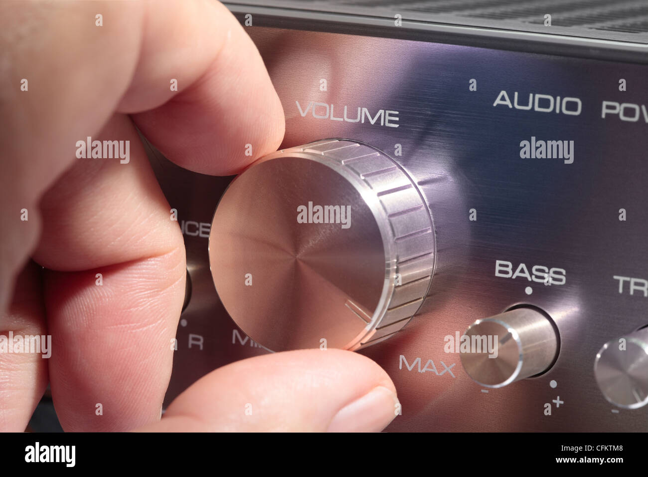Volume Control knob on amplifier turned up full - Stock Image