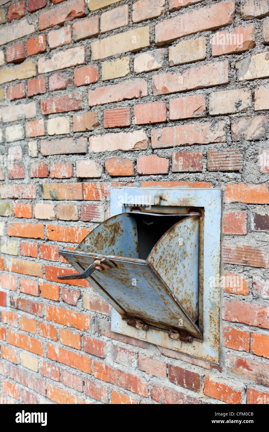 A chute in the side of the gas chamber at Dachau Concentration Camp for the purpose of tipping poison gas into the - Stock Image