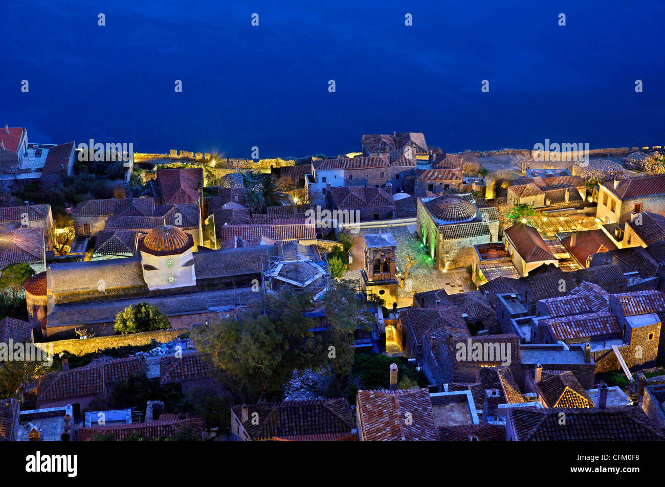 Partial night view of the 'Lower Castle' of the 'castletown' of Monemvasia. Photo taken from the - Stock Image