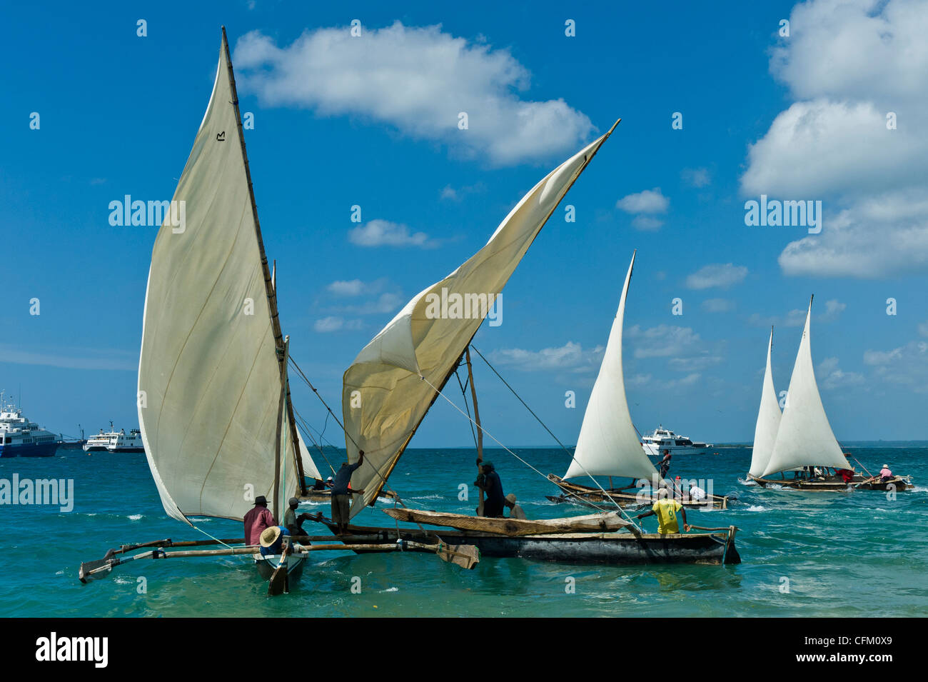 Start of a regatta for 'Ngalawa' the traditional double-outrigger boats in Stone Town Zanzibar Tanzania - Stock Image