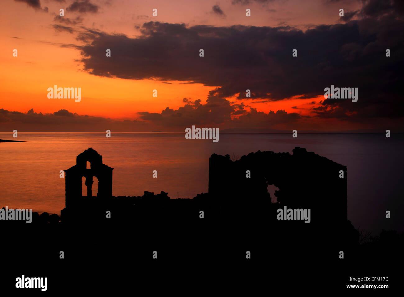 Sunset at the abandoned monastery of Panagia Vretti, Limeni village, Mani, Lakonia, Peloponnese, Greece - Stock Image