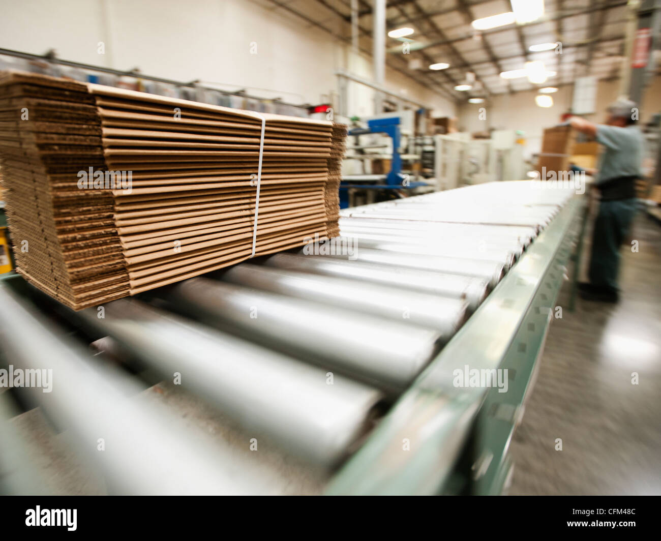 USA, California, Santa Ana, Bundle on conveyor belt - Stock Image