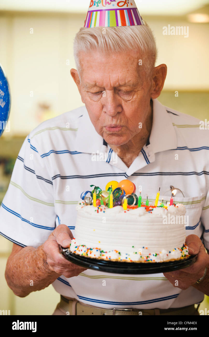 Brilliant Usa Utah Salt Lake City Senior Man Blowing Candles On Birthday Funny Birthday Cards Online Overcheapnameinfo