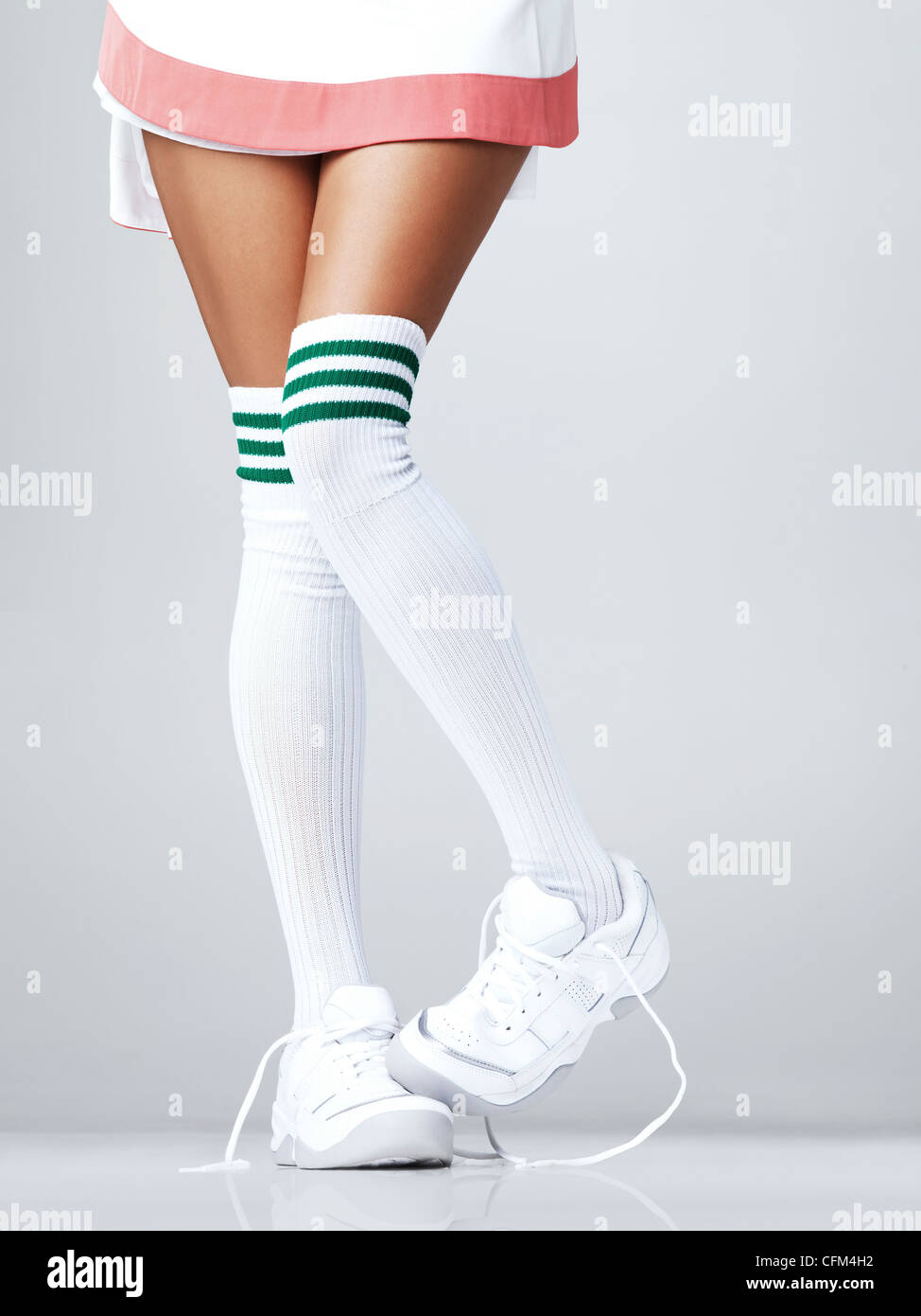 ee2a3b4c2eab Low section of woman wearing sneakers and knee-high socks Stock ...