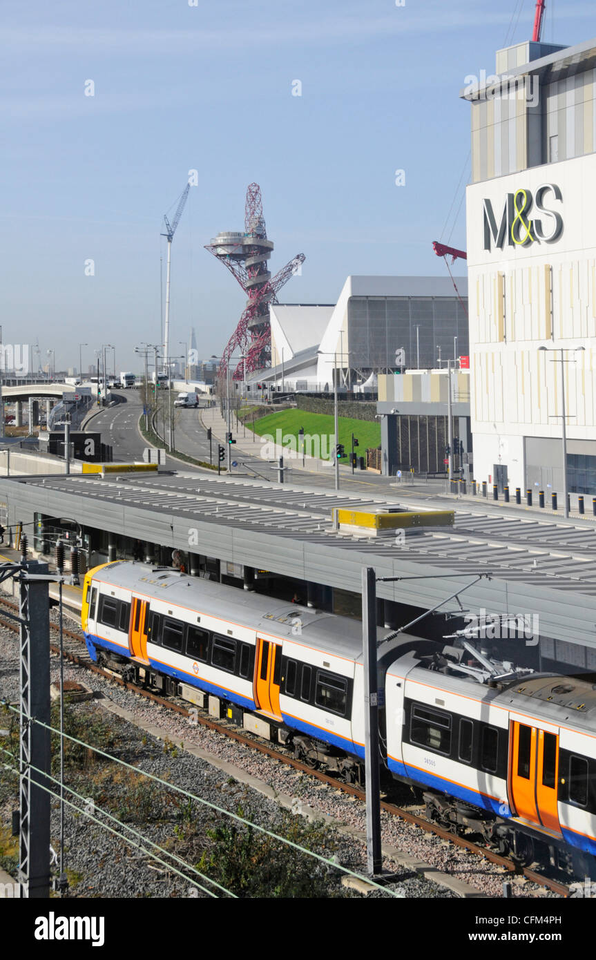 London Overground train Stratford London railway station & M&S sign  Westfield Shopping centre Arcelormittal - Stock Image