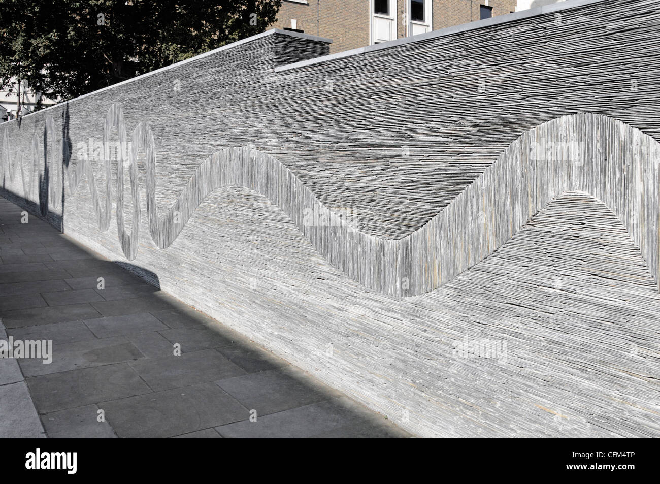 Part of an award winning Slate Wall boundary structure by sculptor