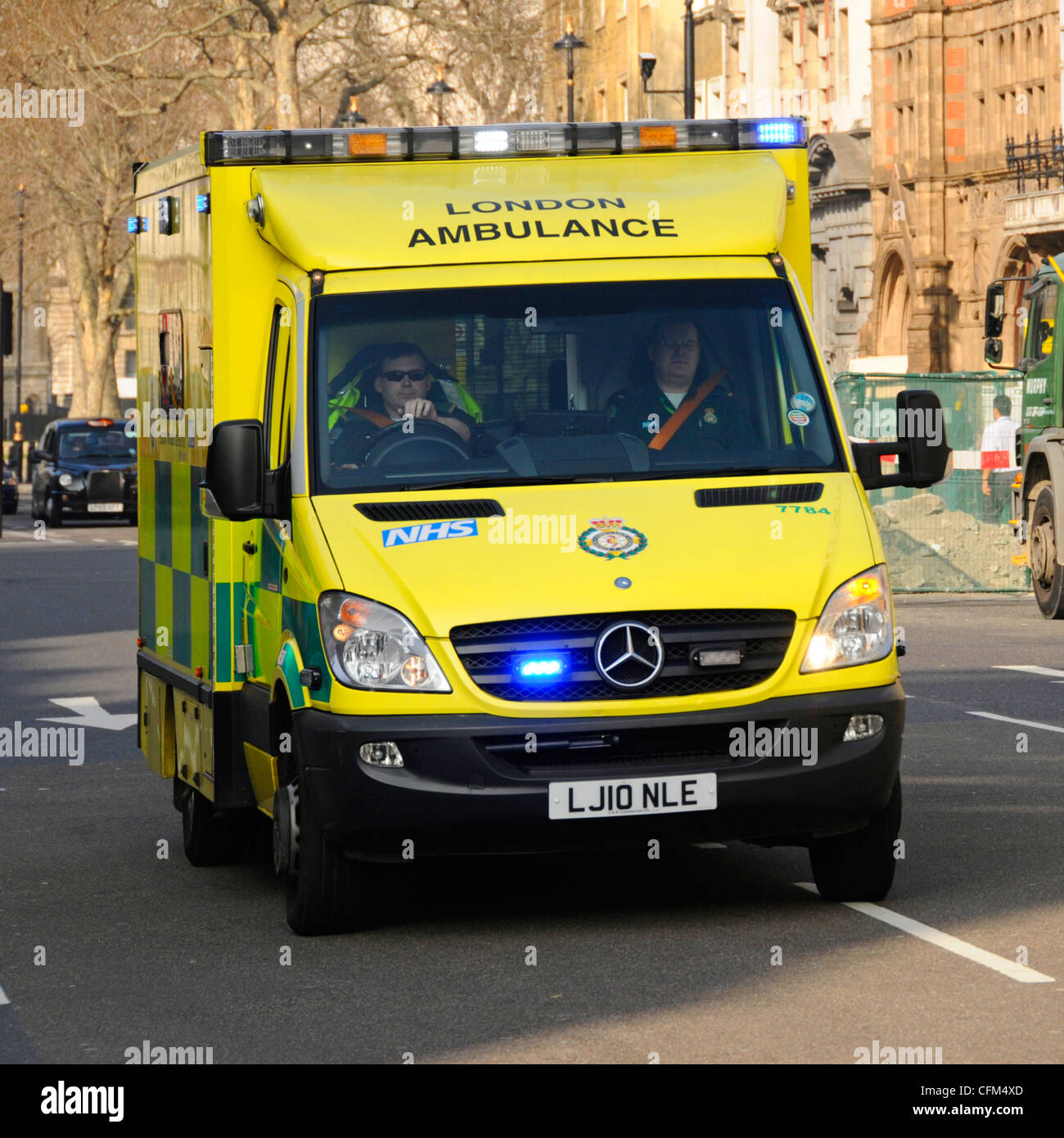NHS London UK ambulance emergency SOS call National Health Service paramedic crew on board responding 999 call driving - Stock Image