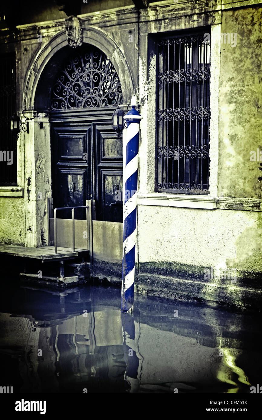 Water entrance to an old Venetian house in Venice, Italy - Stock Image