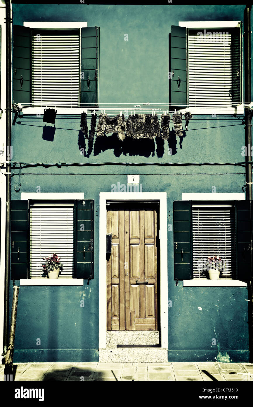 Clothesline in front of a house with rags in Burano, Venice, Italy - Stock Image