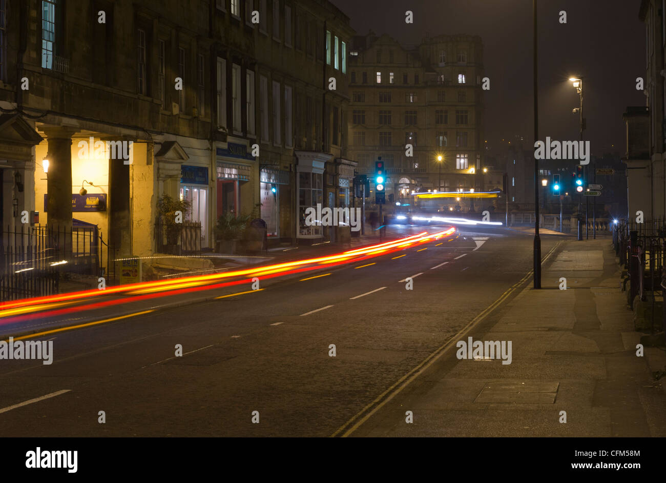 An after dark picture of Manvers Street Bath lit by street and shop ...