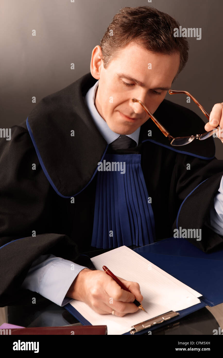 Attorney wearing classic gown in his office - Stock Image