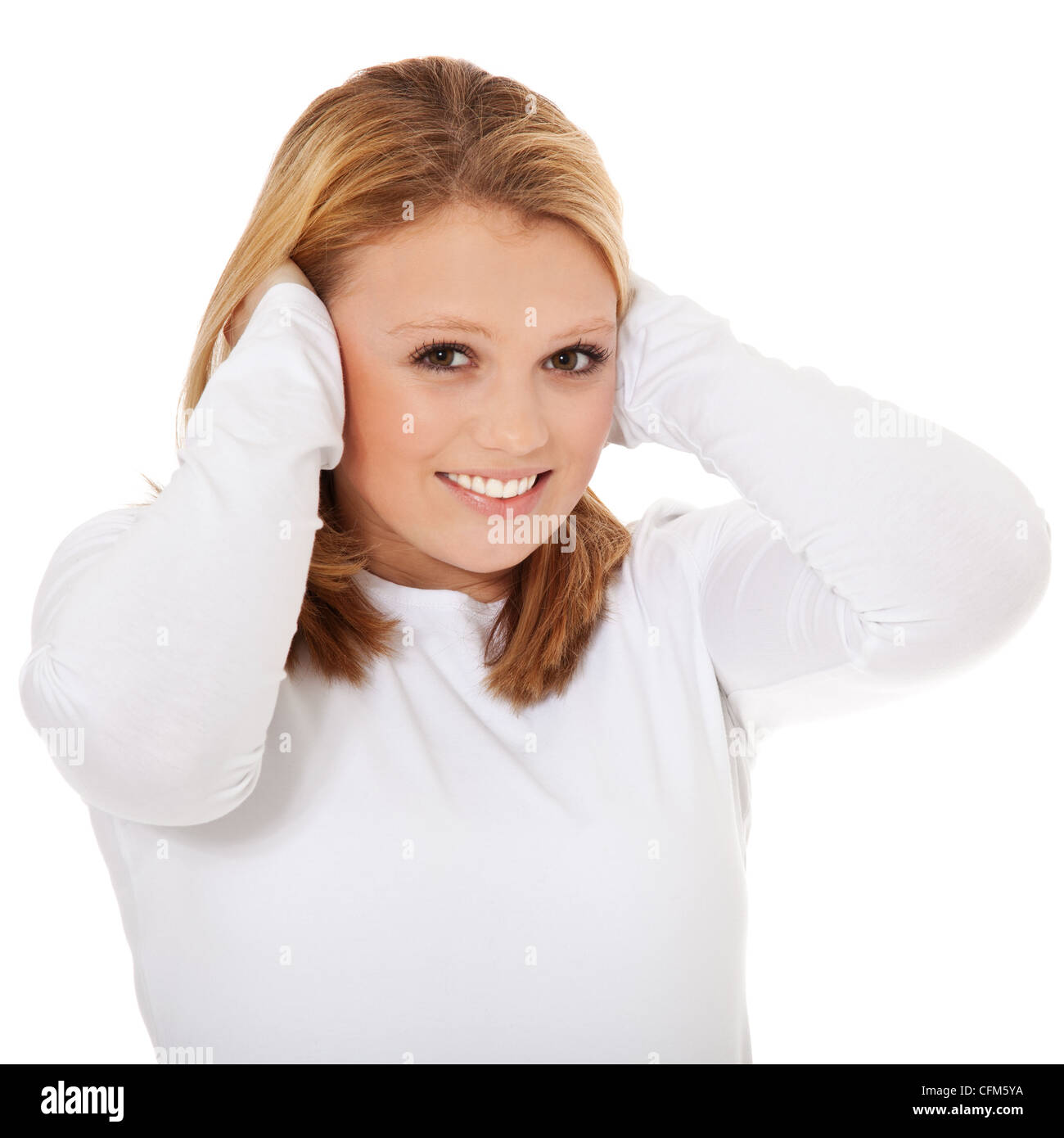 Attractive teenage girl keeps her ears shut. All on white background. - Stock Image