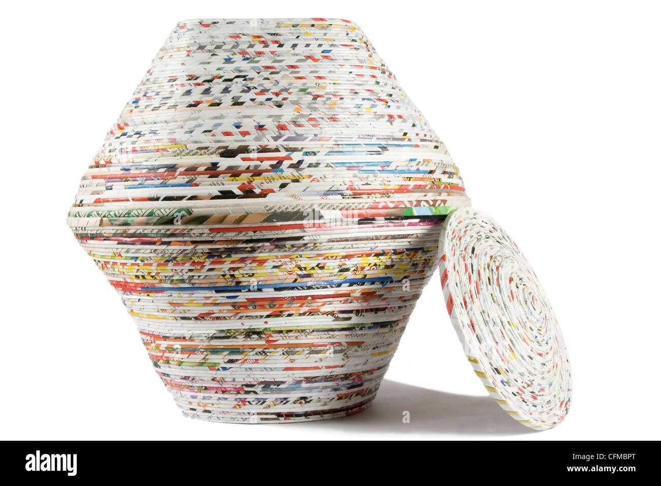 colored basket made from recycled paper on white background - Stock Image