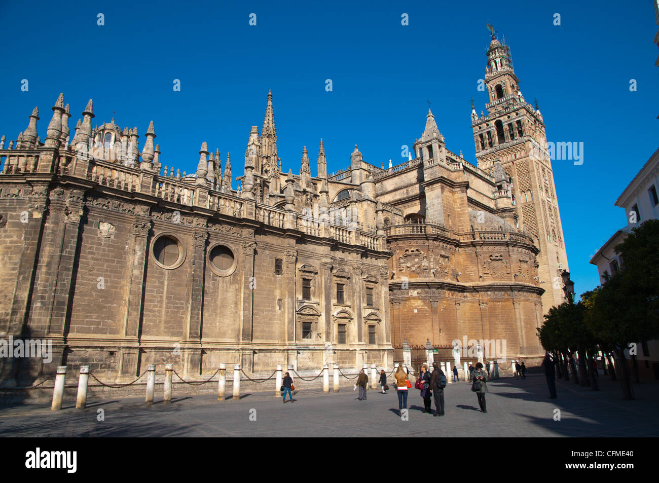 La Giralda and cathedral exterior Plaza Virgen de los Reyes square central Seville Andalusia Spain - Stock Image