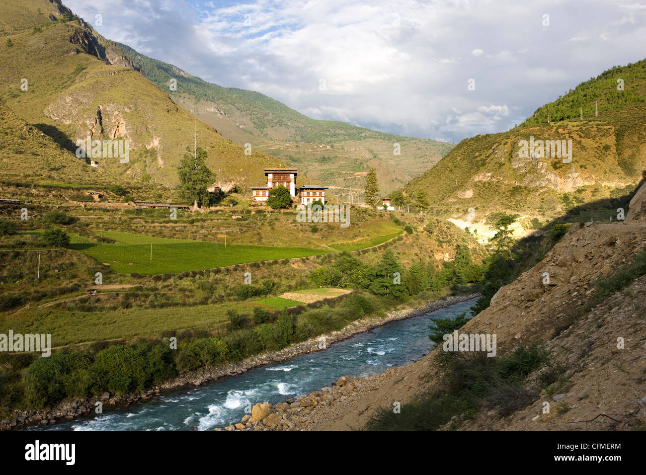 River valley bathed in evening light between Paro and Thimpu, Bhutan, Himalayas, Asia - Stock Image