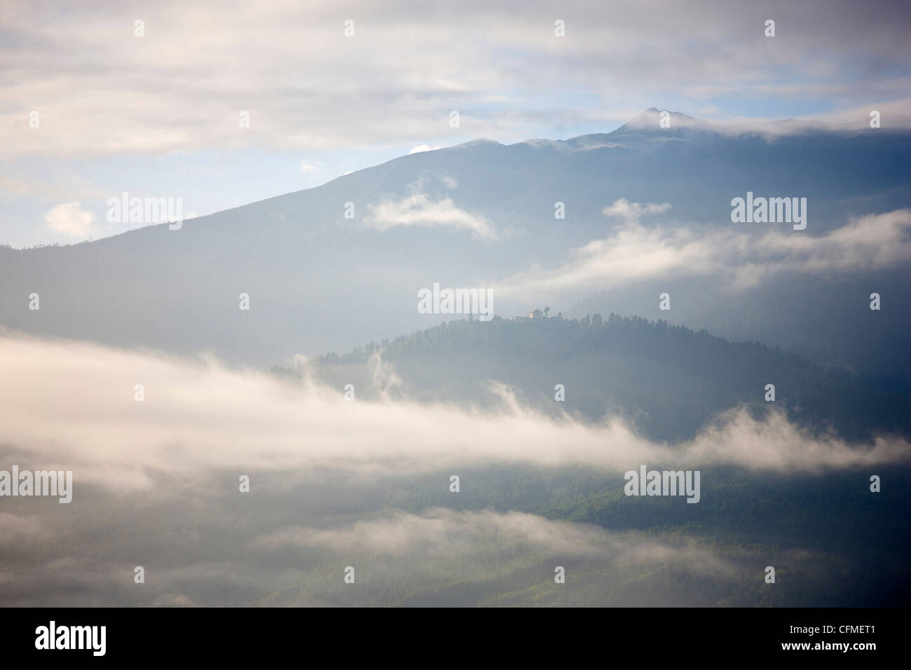 Early morning mist hanging over mountains outside Thimpu, Bhutan, Himalayas, Asia - Stock Image