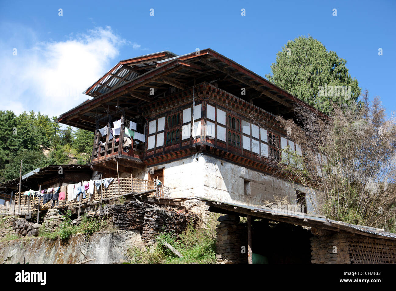 Traditional Bhutanese house in the Bumthang Valley, Bhutan, Asia - Stock Image