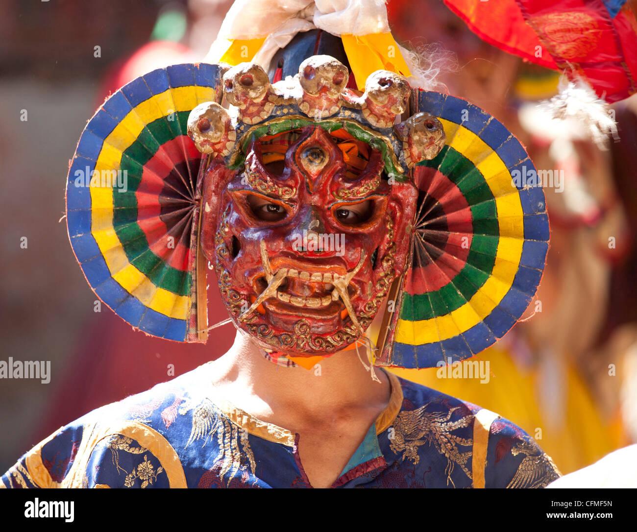 Buddhist monk wearing colourful carved wooden mask at the Tamshing Phala Choepa Tsechu, near Jakar, Bumthang, Bhutan, - Stock Image