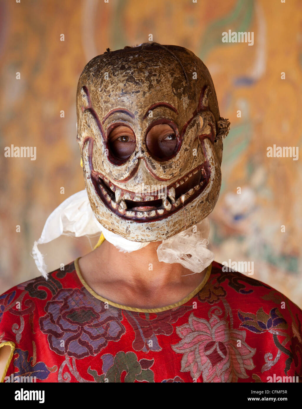 Buddhist monk wearing carved wooden mask, Jakar, Bumthang, Bhutan, Asia - Stock Image