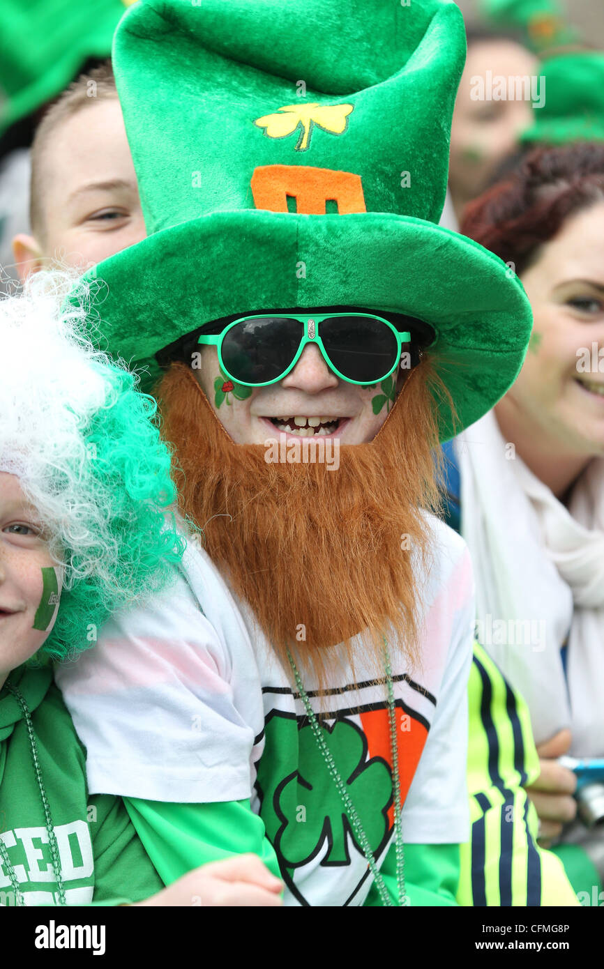 Parade goers are seen during the St.Patrick's day parade in Dublin, Ireland - Stock Image