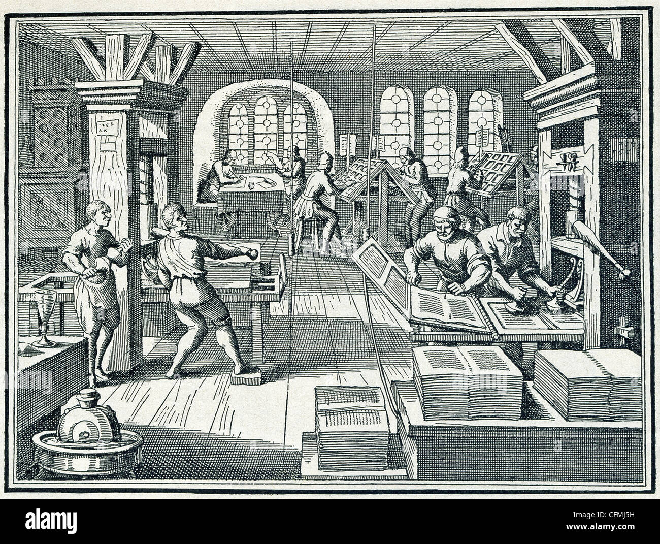 The Swiss artist Jost Ammans did this woodcut illustration of the interior of a printing press house in late1500s. - Stock Image