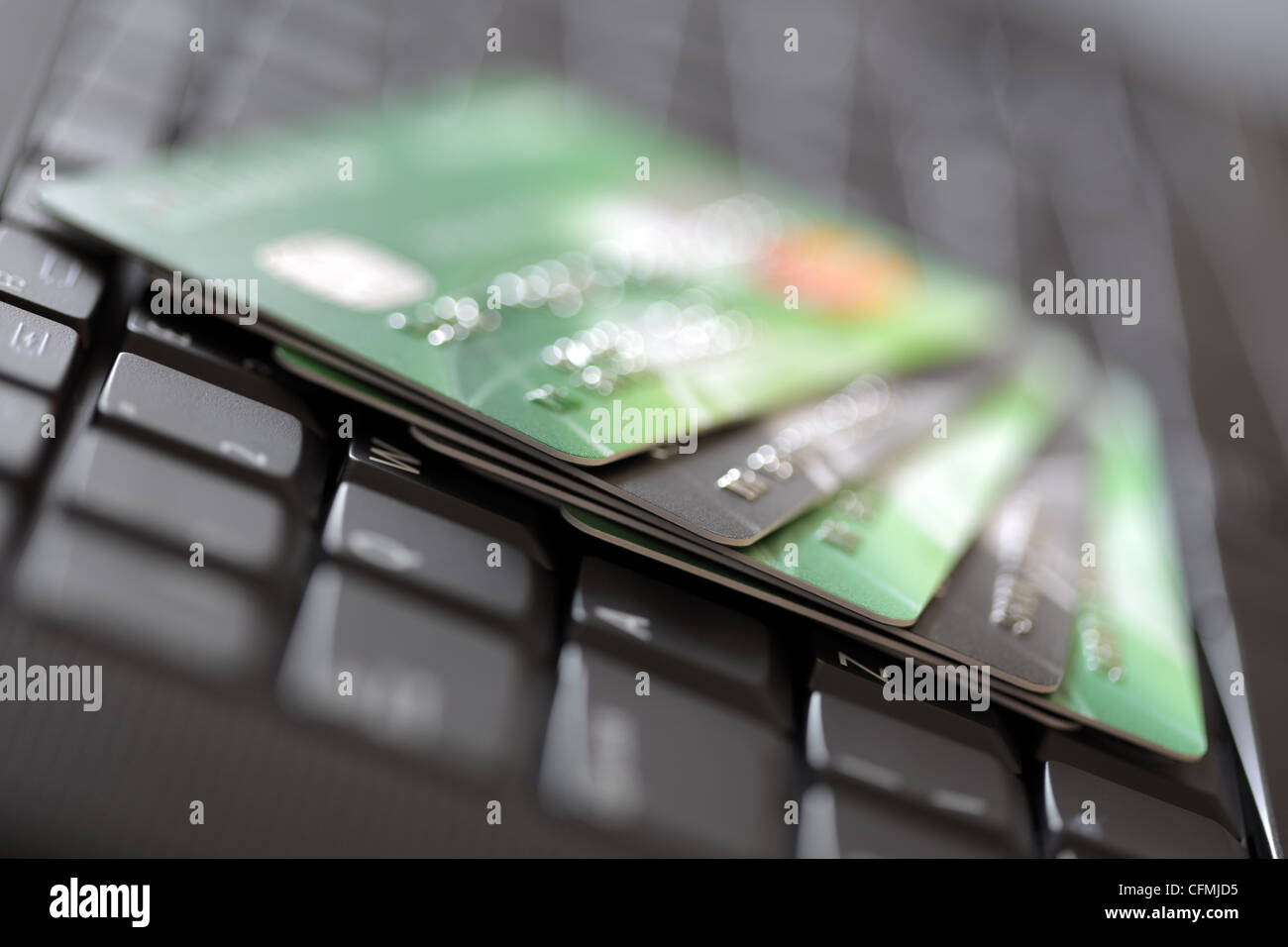 Credit cards on computer keyboard - Stock Image
