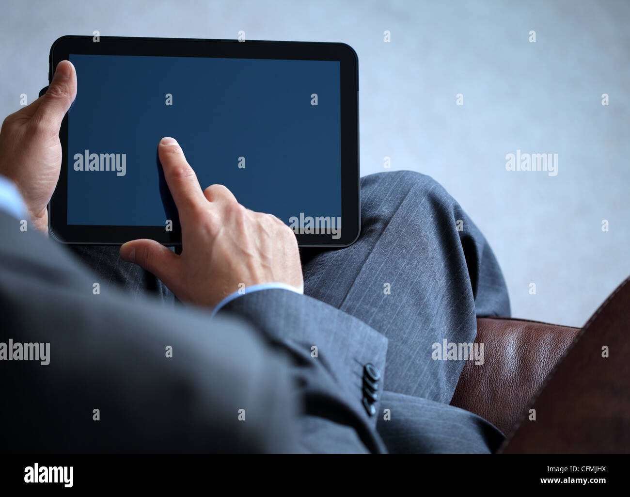 Business man working on digital tablet - Stock Image