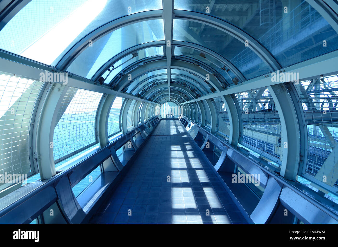 Glass tunnel walkway - Stock Image