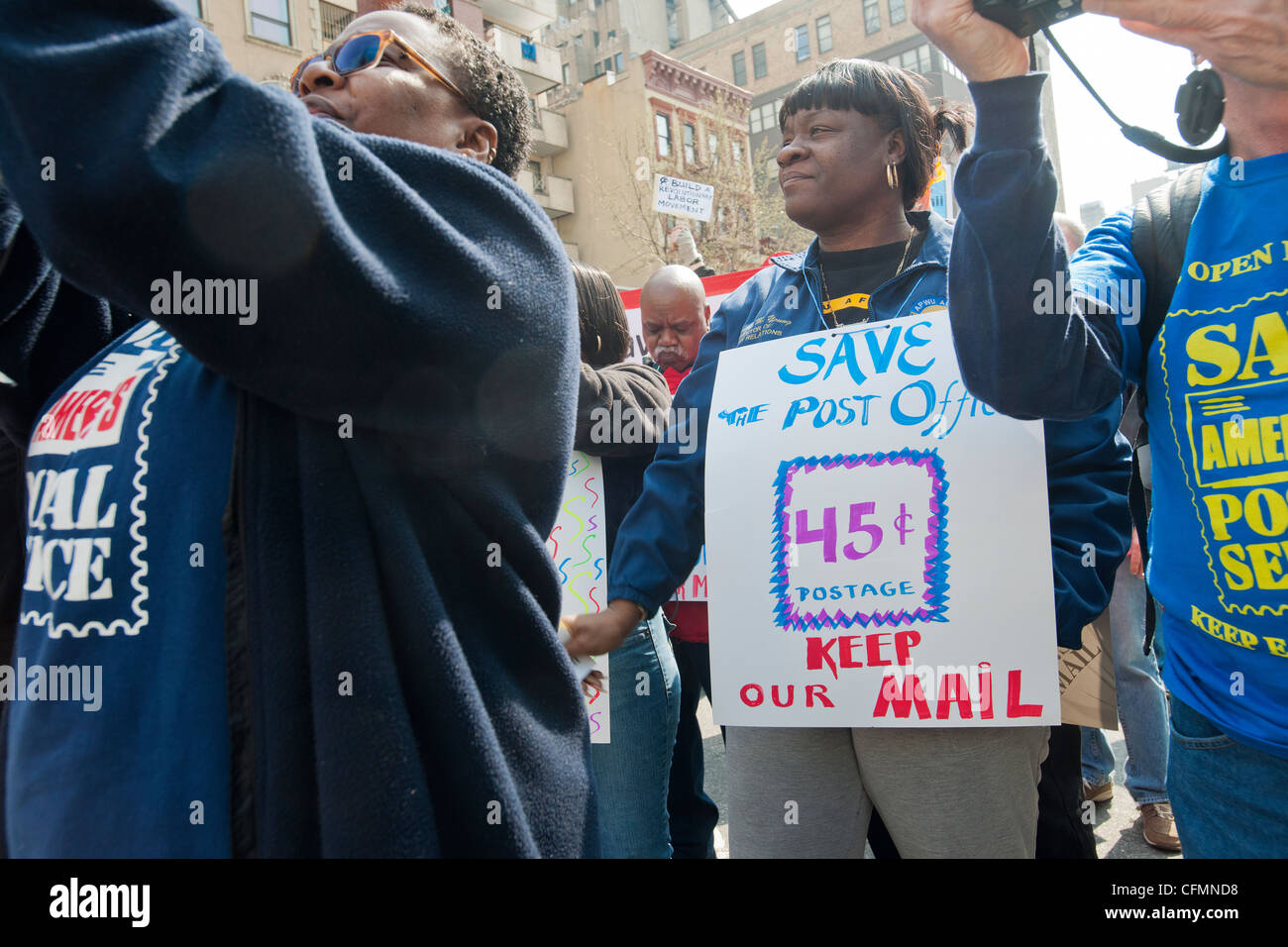 New York Metro Area Postal Union workers and supporters rally to demand continuation of 6 day postal delivery service - Stock Image