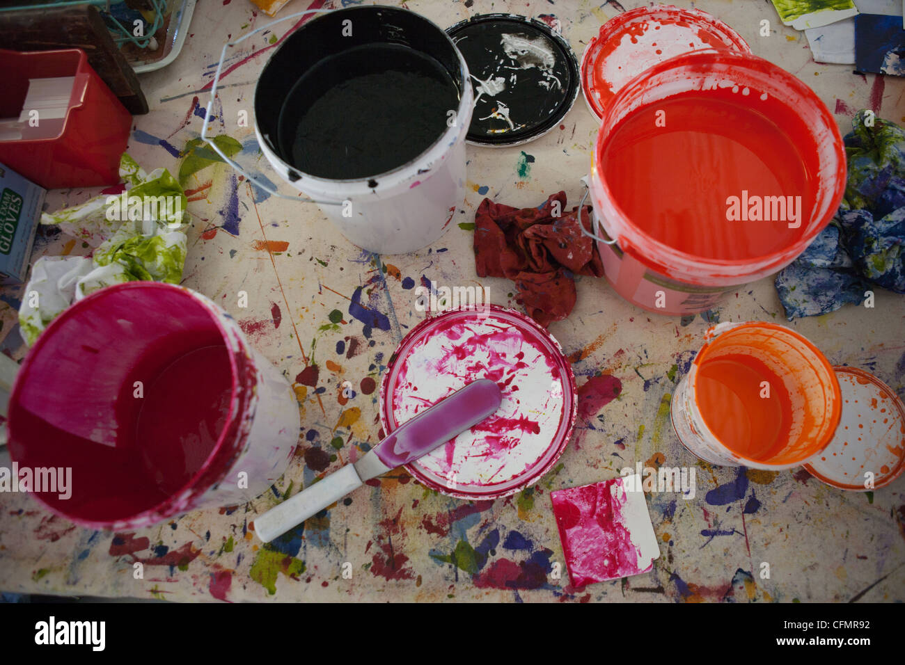 Open tubs of paint. - Stock Image
