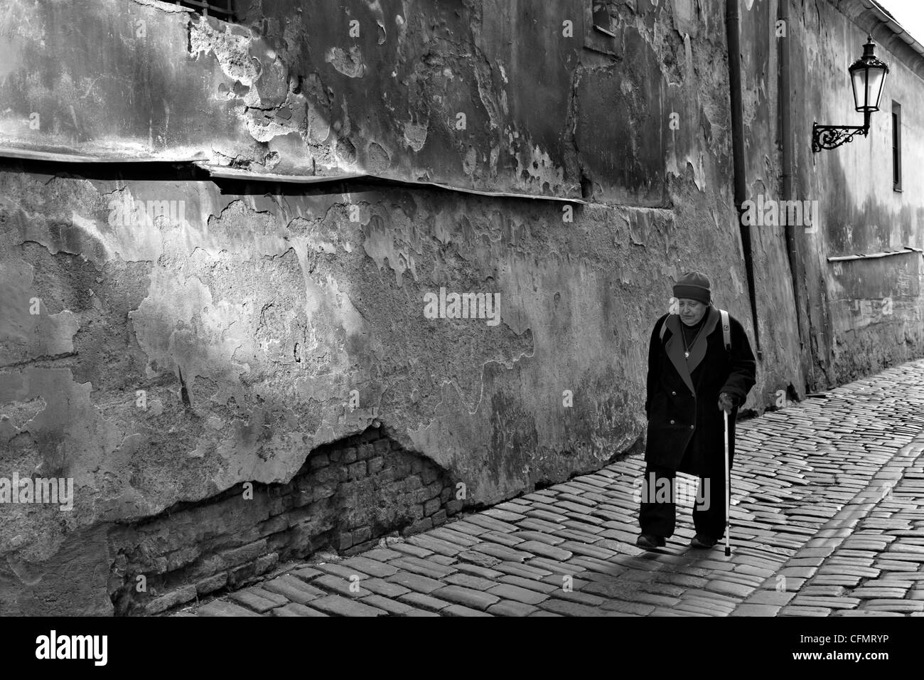 Elderly lady with walking stick at Saská, Little Quarter, Prague, Czech Republic - Stock Image