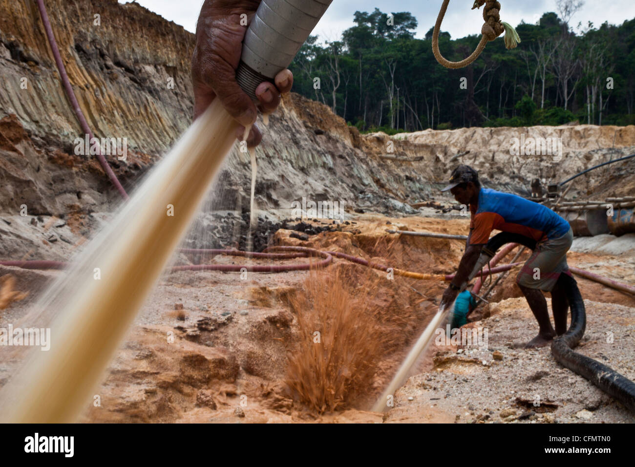 Gold mining Amazon rain forest Hydraulic mining known as chupadeira high-pressure jets of water to dislodge rock - Stock Image