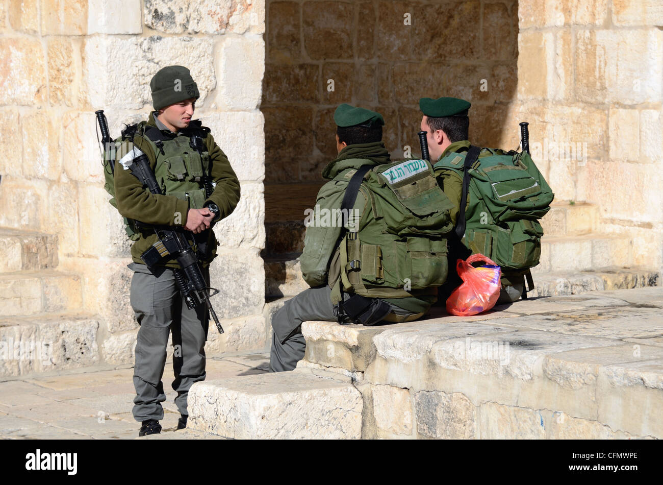IDF Soldiers chat atop the Temple Mount in Jerusalem, Israel. - Stock Image