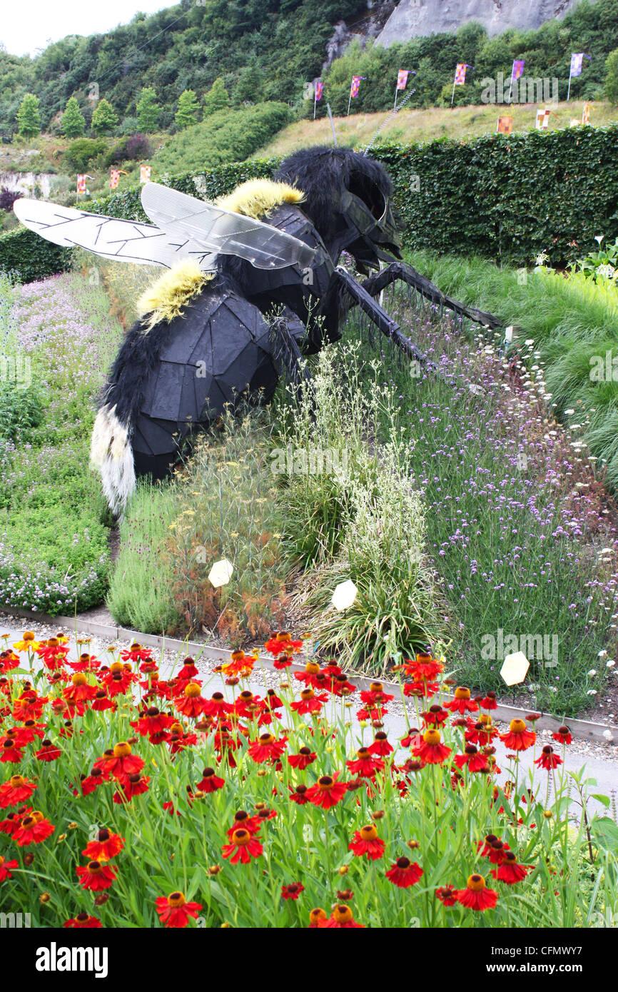 Big bees sculptures displayed in a garden in Eden Project, UK Stock Photo