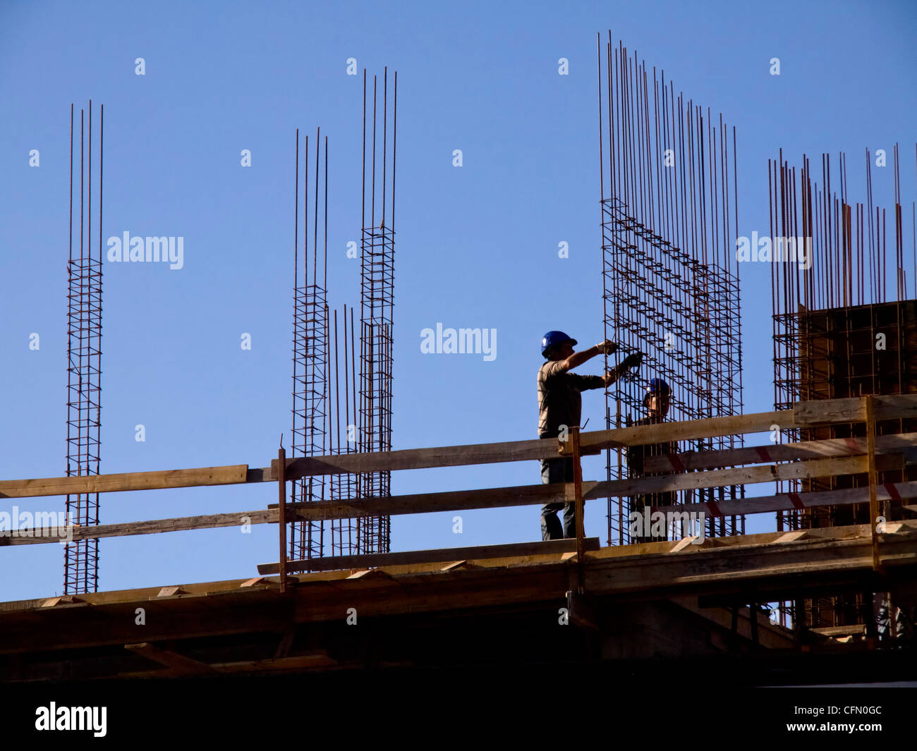 Construction workers at a construction site - Stock Image