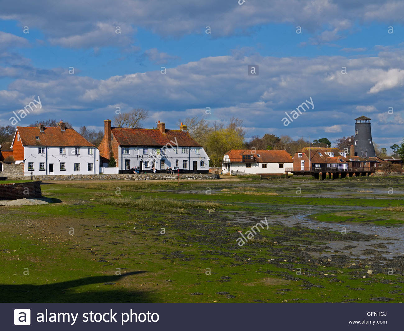Langstone Mill Royal Oak and house Tide out Hampshire England UK - Stock Image