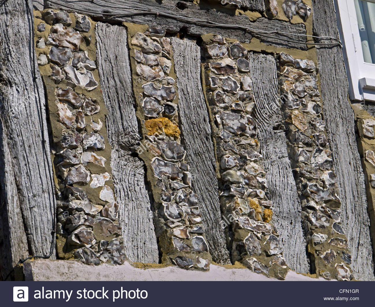 Timber and Flint detail old Tudor House East Meon Hampshire England UK - Stock Image