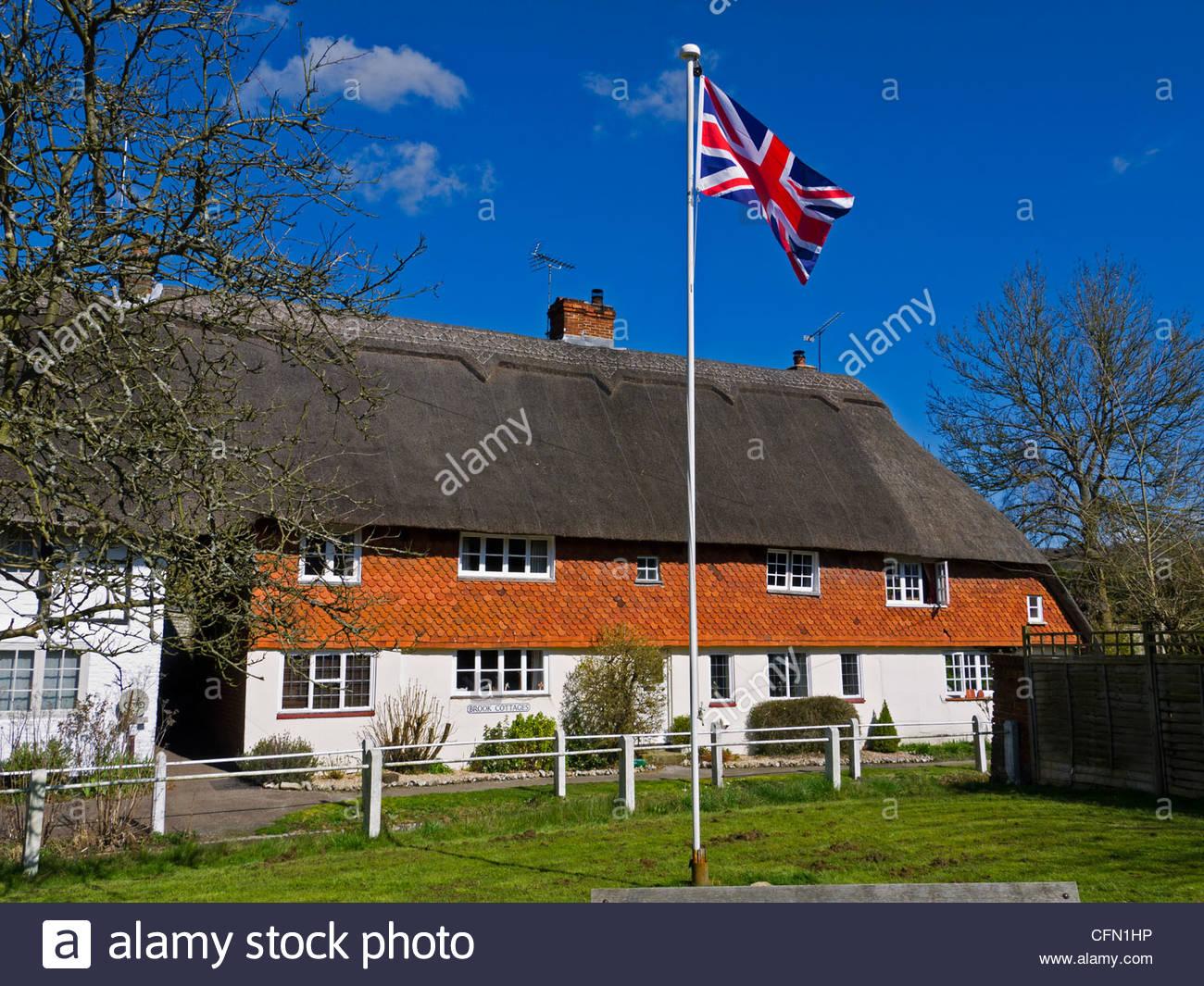 Union Jack Flag and Cottages East Meon Hampshire England UK - Stock Image