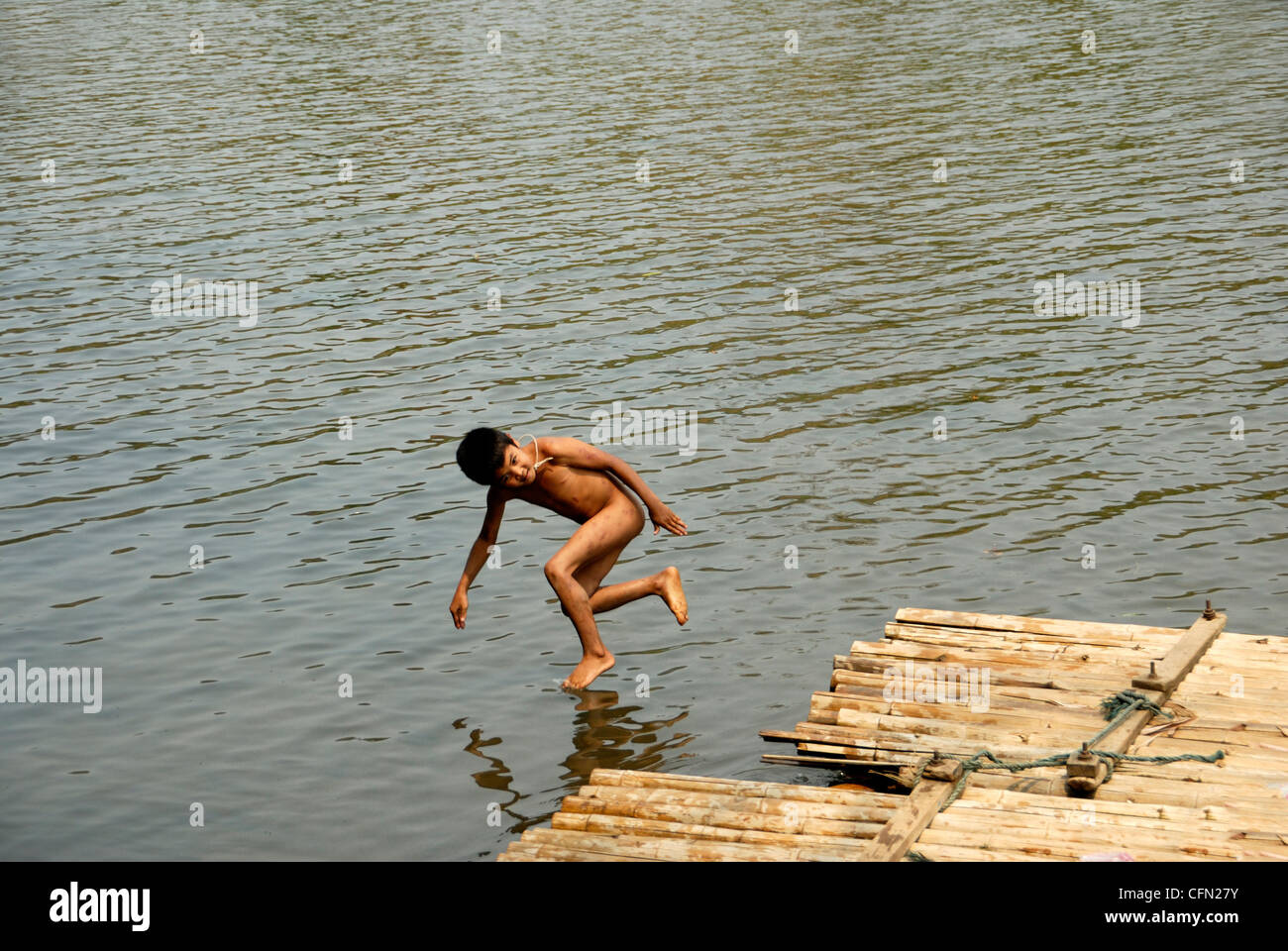 A very hot day boy jumping into the Maechem river to cool off.Maechem Chiang mai.Northern Thailand taken on 14/03/2009 - Stock Image
