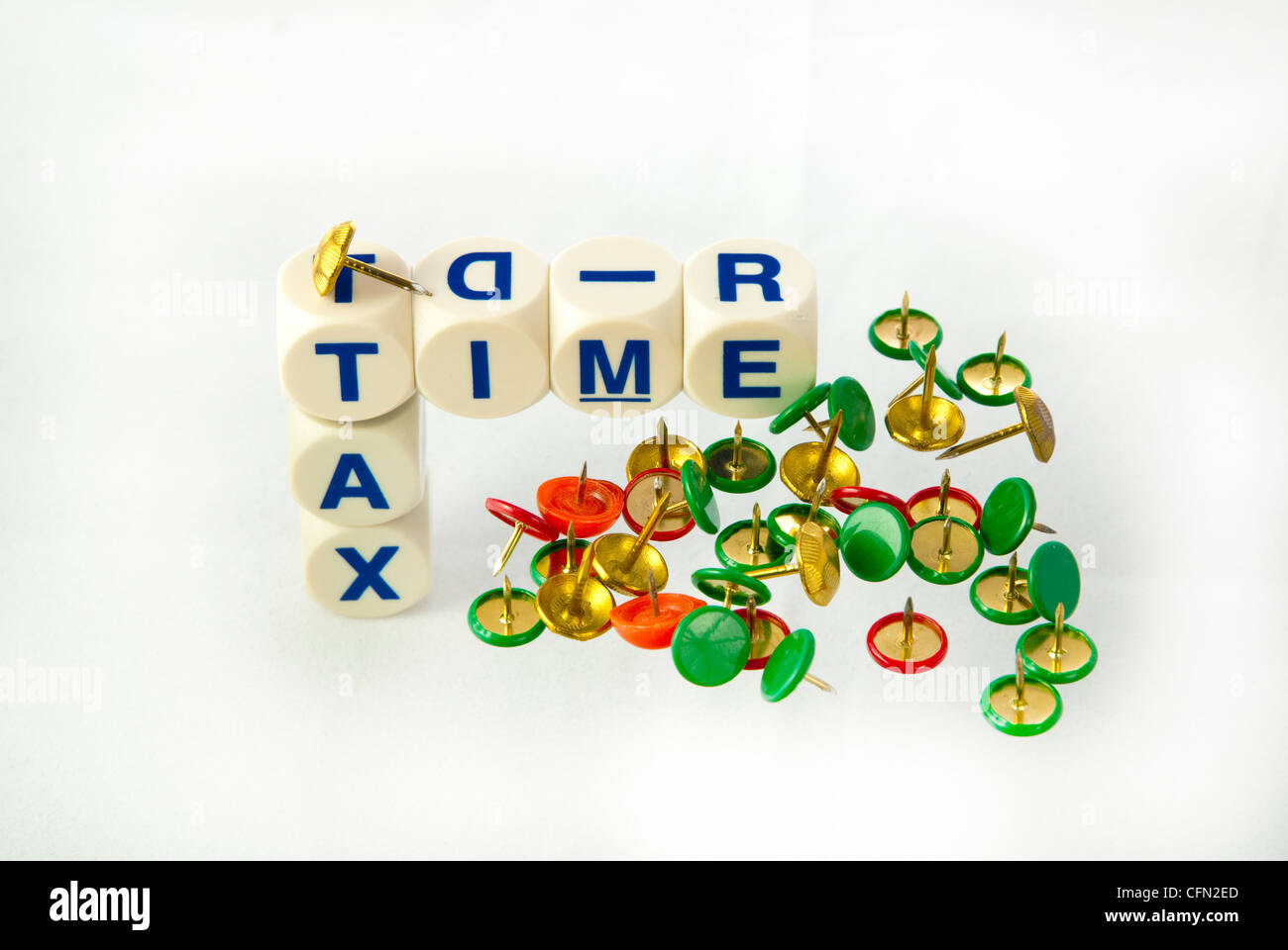 Play on words 'Tax Time, with Thumb Tacks - Stock Image