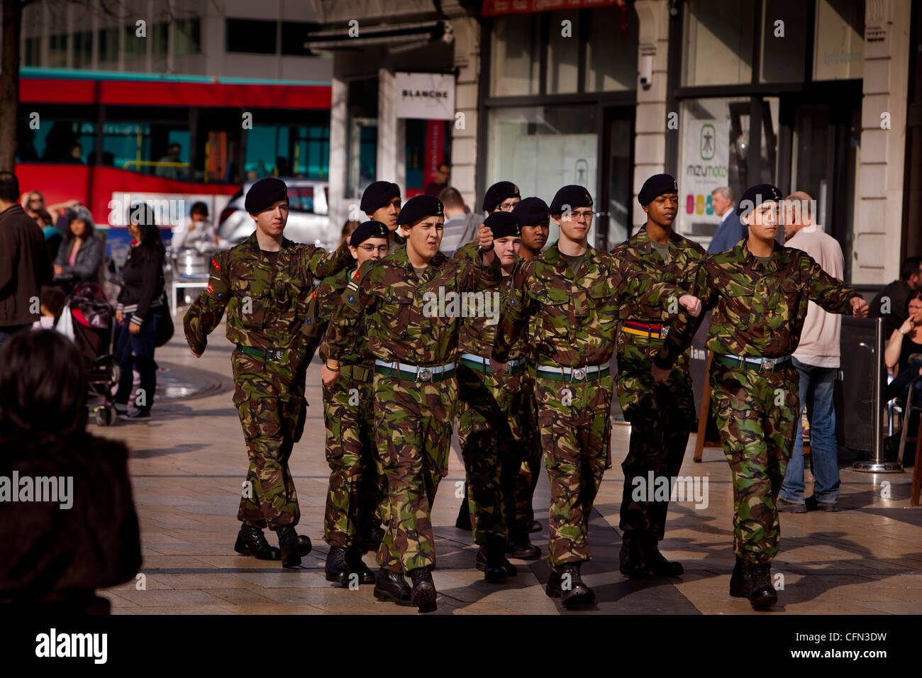 Troops from the Territorial Army regiment The Royal Yeomanry marching through the streets of Hammersmith - Stock Image