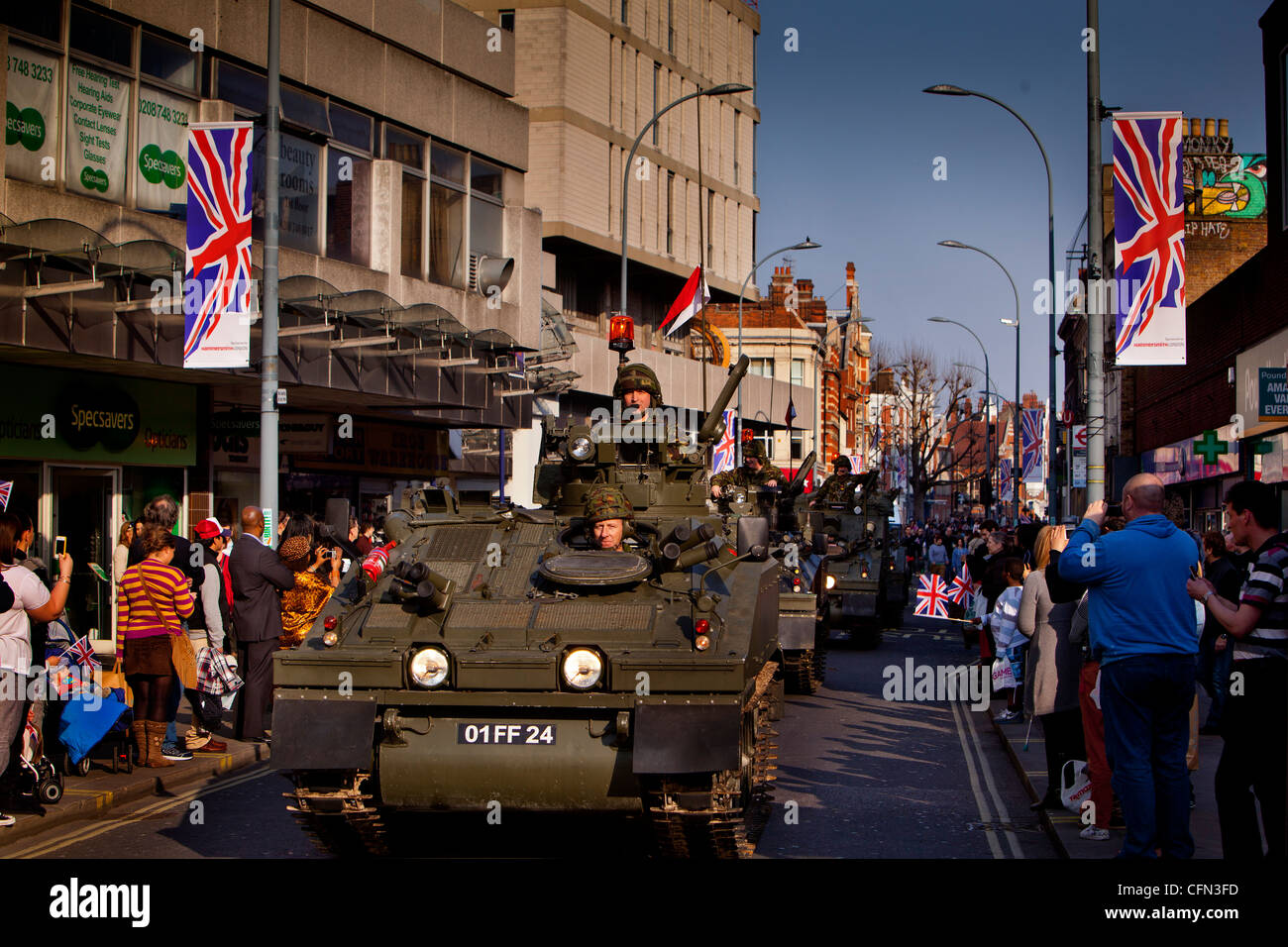 tanks from the Territorial Army regiment The Royal Yeomanry driving through the streets of Hammersmith - Stock Image