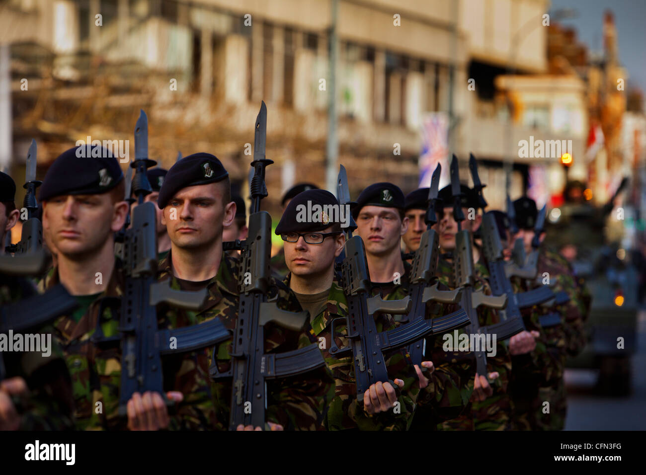 troops from the Territorial Army regiment The Royal Yeomanry marching through the streets of Hammersmith, london - Stock Image